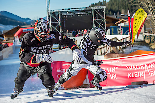 Redlef Cornelis of Belgium and Juho-Ville Haapakangas of Finland (from left) perform during the first stop of the ATSX riders cup, a part of the Ice Cross Downhill World Championship in Wagrain, Austria on December 10, 2016.