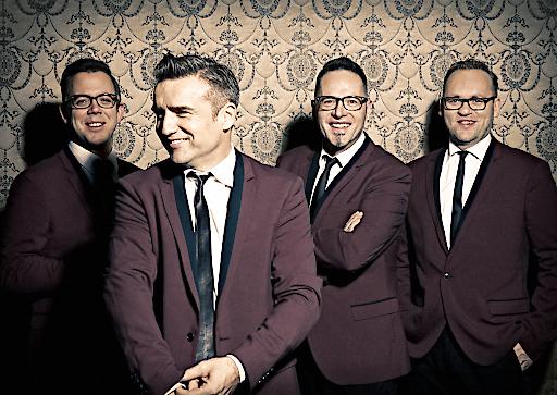 Band-Foto; The Monroes; vier Männer stehend; rote Sakkos;