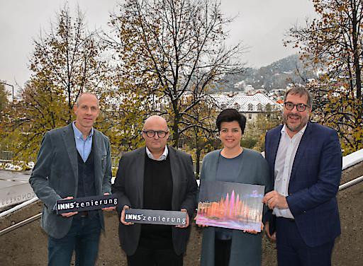 v.l.: Bernhard Vettorazzi (Innsbruck Marketing), Robert Müller (Bartenbach GmbH), Karin Seiler-Lall (Innsbruck Tourismus) und der Innsbrucker Vizebürgermeister Franz X. Gruber präsentierten die INNS'zenierung nahe dem winterlichen Innufer.