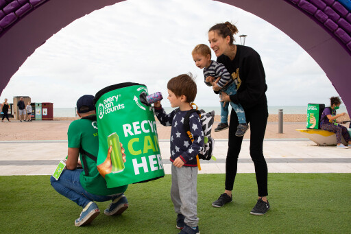 EDITORIAL USE ONLY .Emma Powell with sons Luca aged 18 months and Milo aged 4 recycle a can under a 4x7 metre rainbow arch, made entirely of recycled aluminium cans, which has been installed by recycling initiative – Every Can Counts on Brighton Seafront to encourage members of the public to do the right thing with their drinks cans and recycle them. PA Photo. Picture date: Thursday August 27, 2020. The installation is made up of 2,000 recycled aluminium cans and will remain in situ until the 14th September. The initiative aims to highlight that all cans are infinitely recyclable and there is no loss of quality during the recycling process, no matter the colour, size or shape. Currently in the UK, three-quarters of cans are recycled. Photo credit should read: David Parry/PA Wire